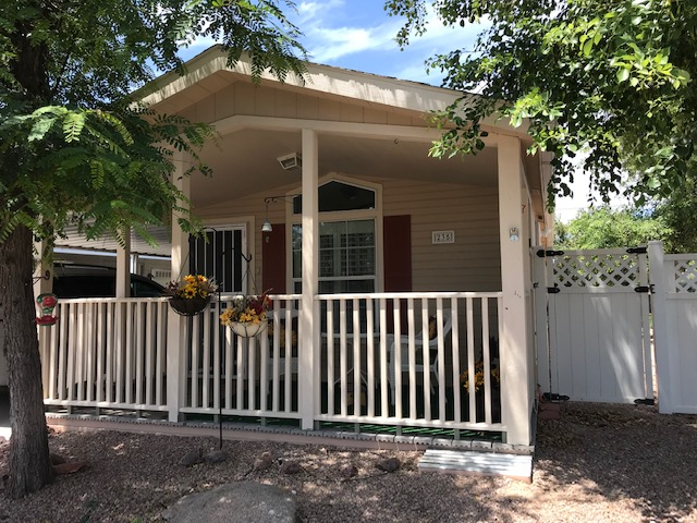 Easy Living in this BEAUTIFUL Ground-Set 16×64 2 Bedroom, 2 Bath Cottage in 55+ Resort Style Gated Community.