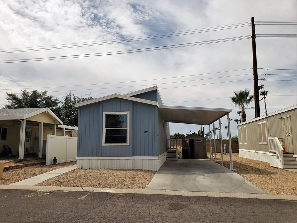 Freshly painted Bright and Airy 2bd 2ba home with New Flooring in a Premier Gated 55+ Community!!!